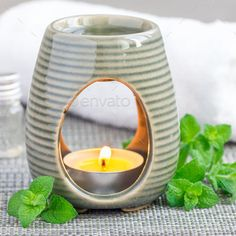 Peppermint essential oil in aroma lamp, square format