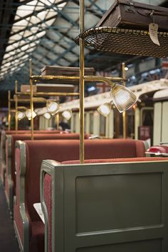 Brass upstand with integrated lighting and luggage rack in carriage seating area