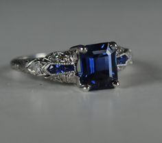 Art Deco royal blue emerald cut sapphire by greenhilljewelers, $3600.00. I would love to have this for my Anniversary this year!!