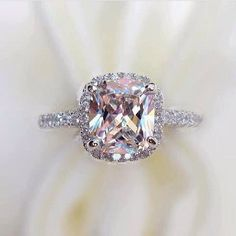 ring with pink and purple hues ~ we ❤ this! moncheribridals.com #engagementring