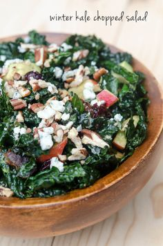 Winter Kale Chopped Salad - chock-full of apples, avocado, dates, dried cranberries, toasted pecans and crumbled blue cheese. Tossed with a honey balsamic dressing to create a sweet, crunchy, incredibly satisfying side dish.