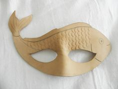 Materials: oz veg tanned leather leather tooling This mask was my sister's idea. She wanted me to do a fish mask so i did this one after sketching a. Animal Masks For Kids, Mask For Kids, Paper Plate Fish, Fish Mask, Cardboard Mask, Fish Costume, Kids Dress Up, Mask Template, Paper Mask