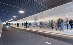 tunnel-7 -- This New Cycle and Pedestrian Tunnel in Amsterdam Features an 80,000 Tile Mural Inspired by Cornelis Boumeester