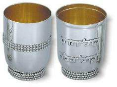 """Sterling Silver Kiddush Cup Set with """"Kol Sasson VeKol Kallah"""" and Pearl Rows by World of Judaica. $1318.00. Dimensions: 8.5cm. Your order includes 1 item(s).. Material: Sterling silver 925. You will be pleasantly surprised! The vast majority of our shipments arrive within 10-14 business days from time of shipment, far in advance of Amazon's default calculation of shipping times for items shipped from Israel.. This sterling silver Kiddush Cup Set features two cups decorat..."""