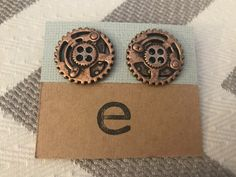Steampunk Copper Toned Cog Studs by Gingerproducts on Etsy https://www.etsy.com/listing/508020343/steampunk-copper-toned-cog-studs