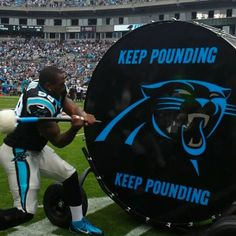 from Carolina Panthers Thomas Davis (@Theresa Danaher) hits the #KeepPounding drum to start the game.