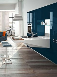 Hideaway wall-mounted kitchen BOARD by @Santiago R. Snaidero Cucine | #Design Pietro Arosio #kitchen #blue