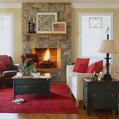 In the Red. Red accents make this living room a welcoming space even on the coldest days. The red area rug fills the ro Living Room Carpet, New Living Room, Home And Living, Living Room Decor, Living Spaces, Decor Room, Home Accents, Red Accents, Do It Yourself Design