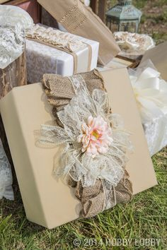 Here's a pretty thought: when you wrap the gifts for your attendants, add some touches that tie them to your décor. We're thinking burlap ribbon, bits of pearl-edged lace, and subtle coordinating flowers.