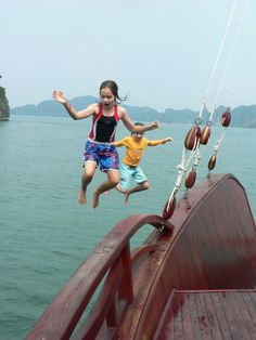 Jumping From Halong Bay Junk: The Red Dragon is three stories high. With 9 and 12 year olds, we sailed Halong Bay for 3 superb nights. The younger brother spotted the opportunity to jump within minutes of anchoring on the first night. His older sister took another 24 hours to muster the courage. This is the moment she leapt. #travel #family
