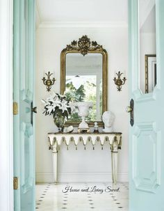 These lovely Aqua double doors open to an exquisite Foyer.The French antiques are gorgeous and quite old.