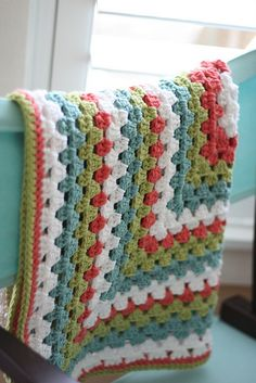 granny square blanket hanging by lauriebeth85, via Flickr- love the colors