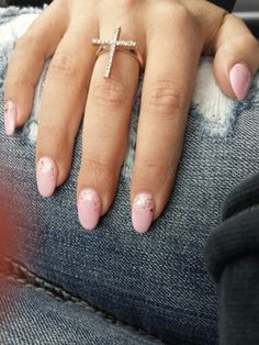 Cascading sparkles on light pink Almond nails. Got my favorite jeans on and I'm ready to take on the world!