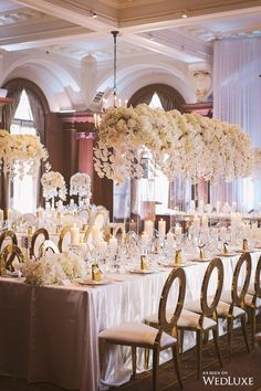 We love these hanging centrepieces! | WedLuxe #Centrepiece #Florals #Orchids #Flowers #FloralDecor #ReceptionDecor #Inspo #WeddingInspo #White