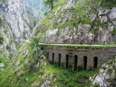 Arches to hold up the path along  Ruta del Cares (The Cares Trail), a popular treking path within the Picos de Europa in Spain - photo by tunante80, via Flickr;  The path is along the Cares River canyon, between the  province of León and Asturias, in Spain
