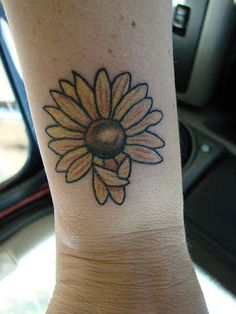 Flower Tattoo # 70 - Hot Daisy flower tattoo inked on wrist. Really love the shape of this daisy flower:)