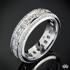 Men deserve diamonds too! Cast in 18k White Gold, this stunning Custom Diamond Wedding Ring holds two rows of A CUT ABOVE® Hearts and Arrows Diamond Melee that flank a center row full of Asscher Cut Diamond Melee.
