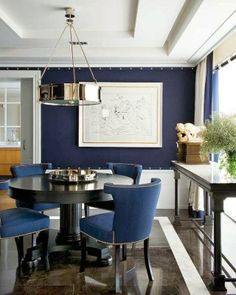 navy blue accent wall with nailhead trim . Pablo Paniagua