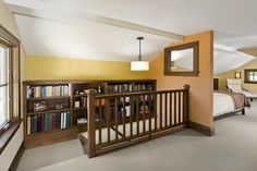 Built in bookshelves near stairway.