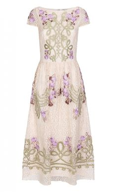 Antila Dress | Midi-Length Dress | Temperley London - With exuberant embroidery onto a demure silhouette, the Antila Dress makes a standout option for evening. Inspired by the vibrant hues and patterns of Spanish folklore, this short-sleeved midi-length dress features lilac-hued satin-stitched embroidered flowers and gold military-inspired details on cream open-weave geometric lace. Also available in red poppy and black as well as red poppy with nude lace. - Composition: 54% Cotton 22%…
