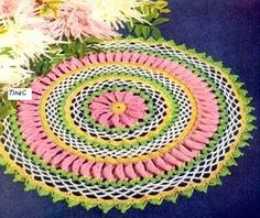MATERIALS:  To make a doily approximately 15 inches in diameter: Size 10 Cotton Crochet Thread in Pink, Green, Yellow and White and a Steel...
