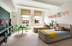 The children's bedroom showcases bespoke upholstered twin beds by Huniford Design Studio | archdigest.com