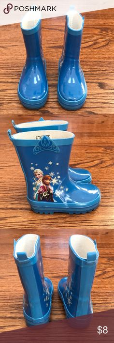 Disney Frozen rain boots Featuring a pair of disney frozen anna elsa blue and whiterain boots. These rain boots have an anna elsa applique on one side and white snowflakes on the other side of the boots. Keep feet dry in the rain.  Worn a handful of times. Disney Shoes Rain & Snow Boots