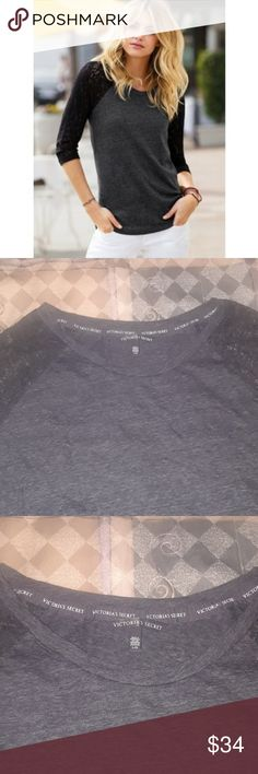 BNIP Victoria's Secret Lace Sleeve Baseball Tee L Clothing item no longer made by VS.  Charcoal grey heather with very dark grey sleeves.  PLEASE SEE PHOTO OF ACTUAL ITEM.  SLEEVES ARE NOT BLACK AS THEY APPEAR IN THE MODEL PHOTO.  The VS name for this color is Black Rinse.  Generously sized, curved hem, angel wing tag at hip. Victoria's Secret Tops Tees - Long Sleeve