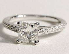 I absolutely love the thin band lined with diamonds with a princess-cut diamond in the middle!