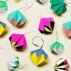 These handmade paper Christmas decorations are not only cost-effective, but they look absolutely stunning. With a couple of packs of origami paper, scissors, glue, a dash of patience and some ribbon, you'll have your very own bespoke paper Christmas baubles! Our mate Emily Dawe will show you how it's done, but for the folds, we'd … Origami Ball, Diy Origami, Basic Origami, Origami Templates, How To Make Origami, Origami Tutorial, Origami Paper, How To Make Paper, Geometric Origami