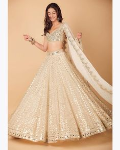 This Manish Malhotra Lehenga looks undeniably pretty because of the gentle colours used it. Moreover, the matching floral embroidery on the lehenga and the blouse makes the whole attire look on point. Disney Wedding Dresses, Pakistani Wedding Dresses, Indian Dresses, Indian Outfits, Bollywood Wedding, Wedding Hijab, Bouquet Wedding, Wedding Nails, Manish Malhotra Lehenga