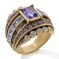 Heidi Daus. Blue isn't my color, but I would love a ring like this with saphires, rubys or diamonds.