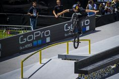 Garrett Reynolds performing a trick with no hands on his BMX in the X Games Barcelona BMX park