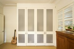 Custom designed doors can ensure your teenager's stuff is hidden from sight. Walk In Wardrobe Design, Bed Wall, Wardrobes, Storage Solutions, Home Office, Custom Design, Doors, Building, House