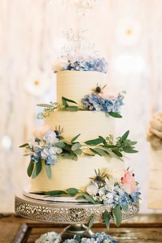 White rose, blue hydrangea, thistle, white stock and eucalyptus bouquets. Venue: Rancho de las Palmas. Photos: Katrina Kim Photo. Flowers; Down Emery Lane