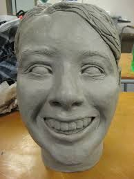 High school ceramic self-portrait lesson based on emotion or adjective