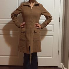Camel colored jacket Long camel colored jacket with zip front and two pockets. Size 8. Shoulder to shoulder seam measures approximately 15 1/2 inches. Shoulder to bottom hem measures about 36 inches. Noticeable pilling on fabric mostly on the front of the jacket and sleeves, as shown in last picture. A few tears in the inside lining. Slight padding in shoulders. Divided Jackets & Coats