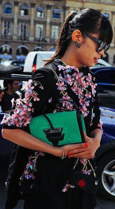 Leaf Greener wears a Romance Was Born dress, AM Eyewear sunglasses, and a Loewe bag at the Schiaparelli show in Paris