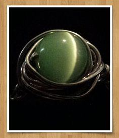 Check out this item in my Etsy shop https://www.etsy.com/listing/198112280/green-wire-wrapped-ring