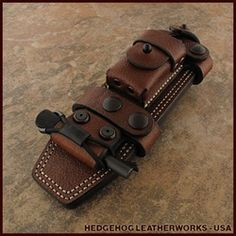 Sheath For The Full Size Ka-Bar Knife.  These guys are awesome.  Everything handcrafted!  Would be a nice gift for outdoors folks!  Note the fire striker built in!