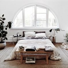 Jute Rug - Arched Window - Cozy Bedroom - Natural Lighting - Neutral Bedding