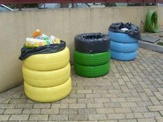 Fun recycling ideas, using old tyres. Colour code them and line them for easy removal.