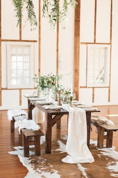 modern rustic table - photo by Samantha Jay Photography http://ruffledblog.com/swiss-chalet-wedding-inspiration
