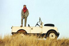 """""""Bandbox"""" Spot on with quality suit & colour. Sharp Red Scarf fits scene. Jeep in rocking."""