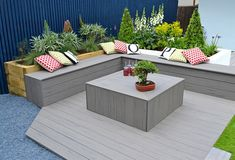 from per Silver Maple Composite Decking from per Silver Maple Composite Decking from per If you have green fingers and want to add an extra dimension to your deck, why not use our composite deck boards to create beautiful planters! Wood Floor Design, Outdoor Sectional Sofa, Garden In The Woods, Recycled Decking, Composite Decking, Patio Design, Deck Seating, Floor Design, Outdoor Furniture Sets