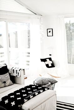 Luckyboysunday / Cross pillow / Eames rocking chair / Gran blanket by Fine little day