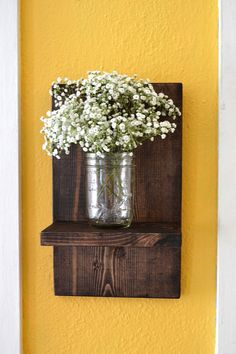 This wall sconce will add a rustic touch to your home! Display candles, knickknacks or mason jars of flowers. Hanging hardware is included.