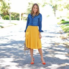Inspiration: Sole Society    I love primary colors, and today's inspiration photo is no exception. Her  look is bit edgy (love), and mine has a preppy vibe thanks to the collared  shirt and A-line skirt shape. My shoes are technically more orange than  red, which is a great way to achieve a toned down primary colors look.  Would you wear this color combo?  Shirt: Mudd c/o Kohl's, old (similar below) Skirt: ModCloth c/o, $50 Shoes:Ivanka Trump/Saks Off Fifth, $60 (same,same)…