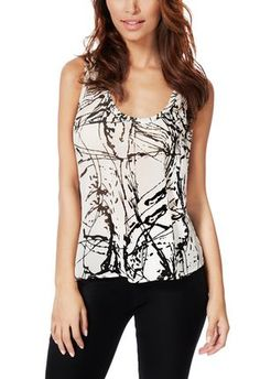 This is the best ever! I just noticed this flowy racer back tank from @justfabonline This pattern is everything #justfabapparel