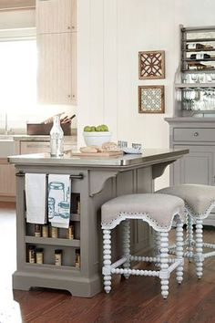 """""""The Kitchen Island"""" is part of the Paula Deen Dogwood Collection. The island features five drawers, two cabinets, towel rods and open storage on one end for unbeatable functionality in a small space. Metal wrapped top is easy to clean and is extremely durable for food prep or eating. Crafted of select hardwoods and veneers with the Cobblestone painted finish. Brushed metal hardware completes the look."""